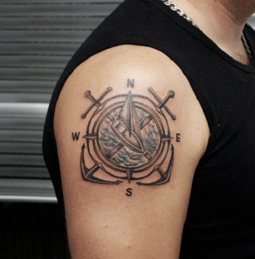 Compass Tattoo With a Sailing Boat in the Middle.