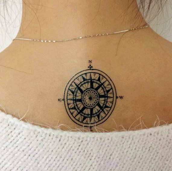 A stylish compass tattoo